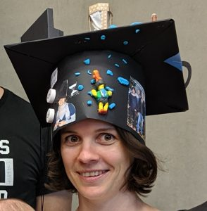 [photo of Sarah Kaspar with doctoral hat]